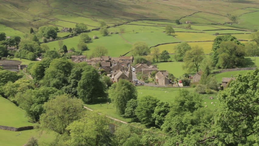 Typical english countryside showing a valley and village on a typical english countryside showing a valley and village on a sunny day in the yorkshire dales sciox Image collections