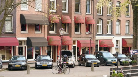 Amsterdam, April 2017. Prostitute windows with red canopies on canal in Amsterdam.