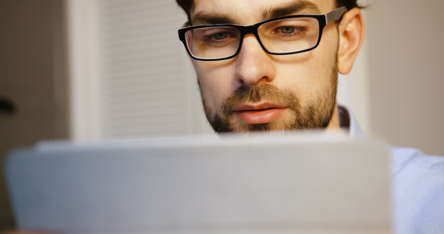 Young business man working at laptop in office. Attractive man typing on laptop. Close up. | Shutterstock HD Video #26225777