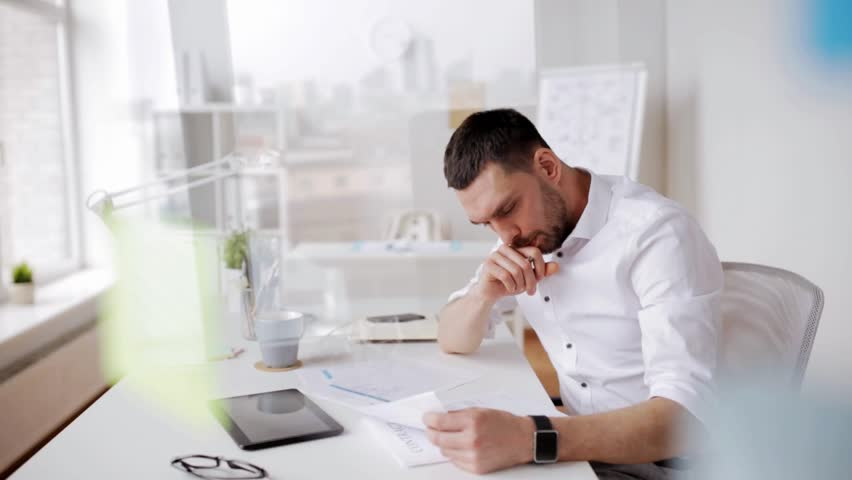 Business, people, paperwork and technology concept - businessman with tablet pc computer and papers working at office | Shutterstock HD Video #26238779