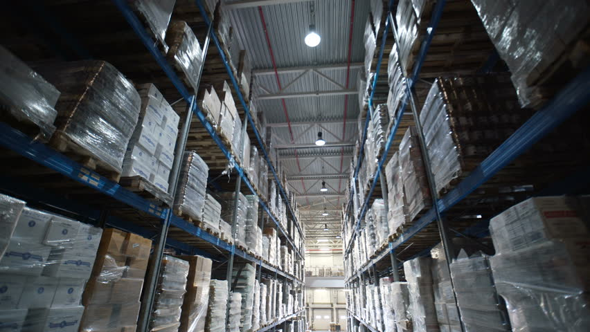 big factory warehouse. store Aisles. Camera travels inside a large store. Warehouse shipping. Logistics business and shipping facility with forklift to move boxes and goods