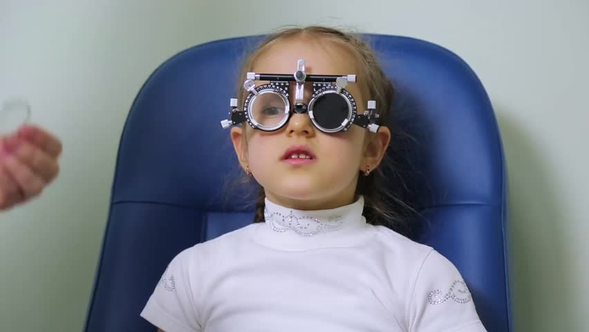 Eye test of the child using the diagnostic lenses | Shutterstock HD Video #26301395