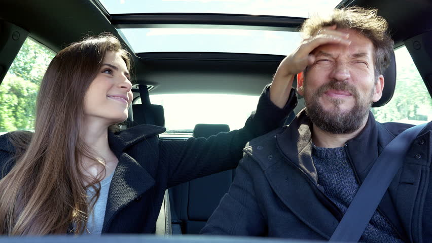 Couple Laughing Joking In Car Driving In Love #26398715