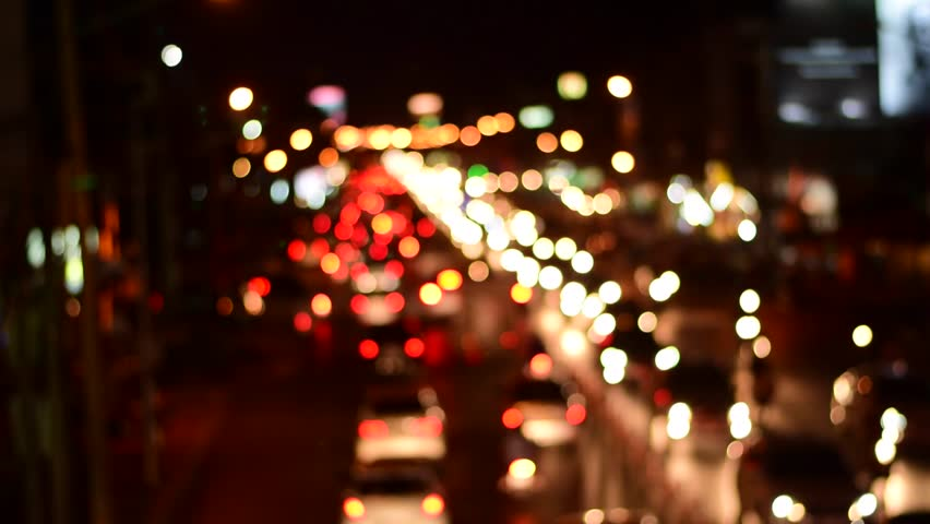 Blurred car lights. Out of focus traffic lights of cars on the sreet. Bokeh lights from traffic jam on night time for background. Beautiful background on dark, out of Focus Lights during the Night.