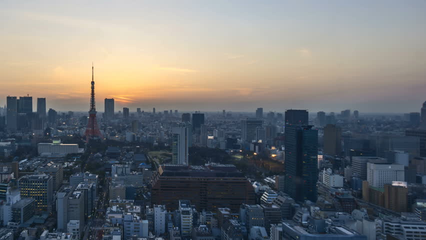 4k time lapse of night to day sunrise scene at Tokyo city skyline with Tokyo Tower. pan left   Shutterstock HD Video #26419385