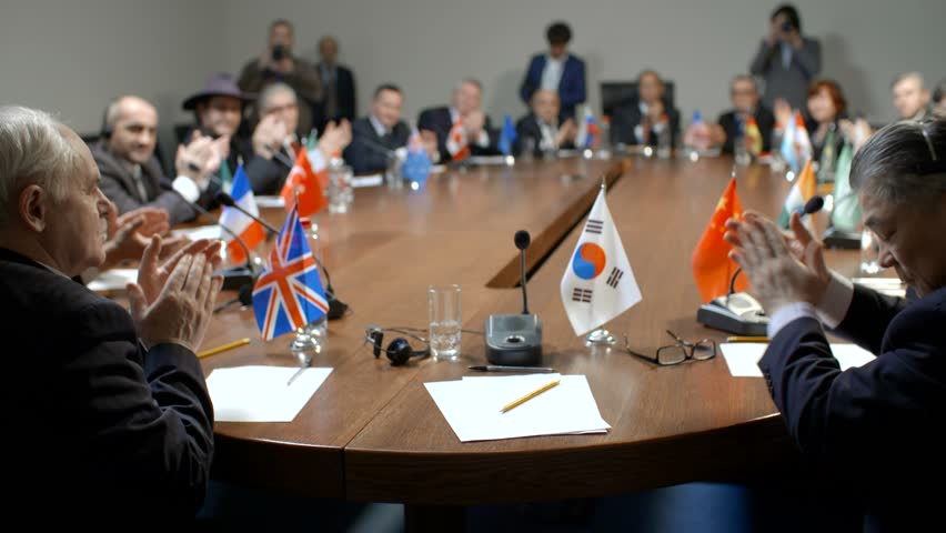 South Korea delegate at the round table during multinational pilitical debates or negotiations. | Shutterstock HD Video #26426915