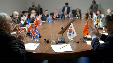 South Korea delegate at the round table during multinational pilitical debates or negotiations.