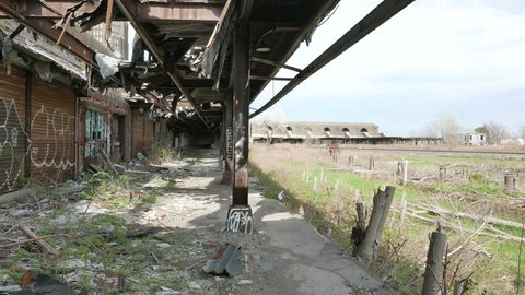 BUFFALO, NEW YORK - APRIL 27, 2017: Buffalo Central Terminal, a historic former railroad station in Buffalo, New York. In use from 1928 until abandoned in 1979. Stabilized walking shot of platform.