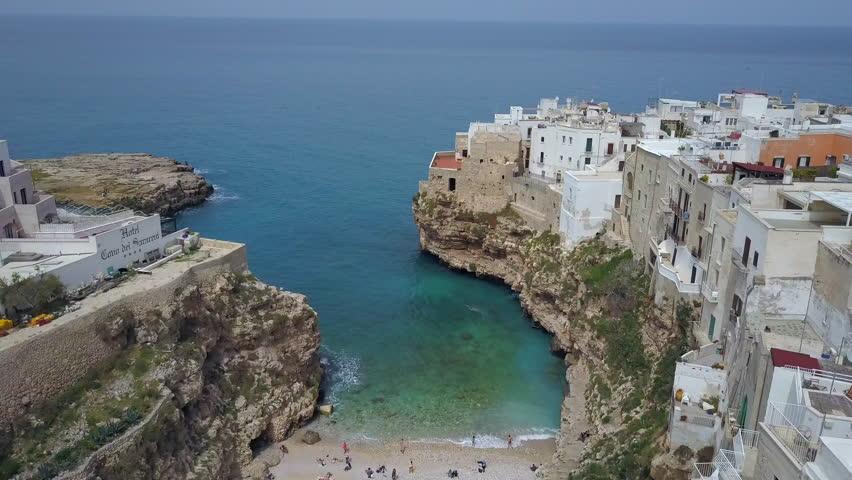 Polignano a Mare (Bari, Italy): heaven on earth. Coastal 4k aerial drone footage video above sea