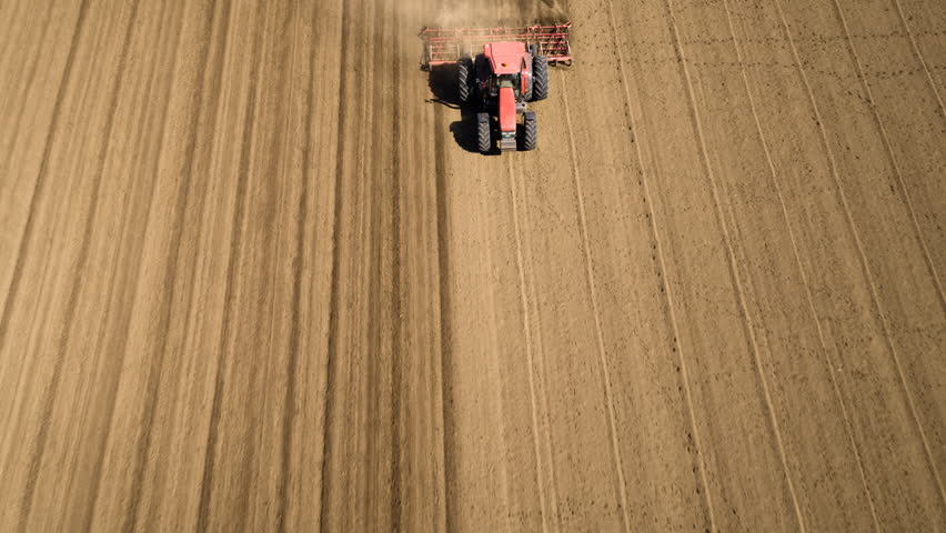 Tractor cultivating arable land for seeding crops, aerial view | Shutterstock HD Video #26460905