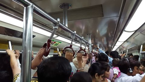INDIA - CIRCA JUNE 2016 - Inside extremely crowded packed busy subway metro train ride, New Delhi, India