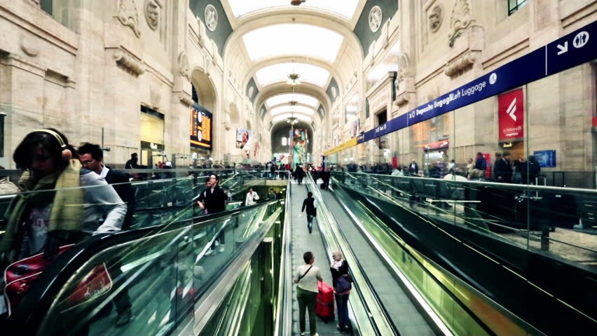 MILAN, ITALY - MAY 2012: Time lapse shot of passengers at an railroad station, Milan, Lombardy, Mediterranean Sea, Italy
