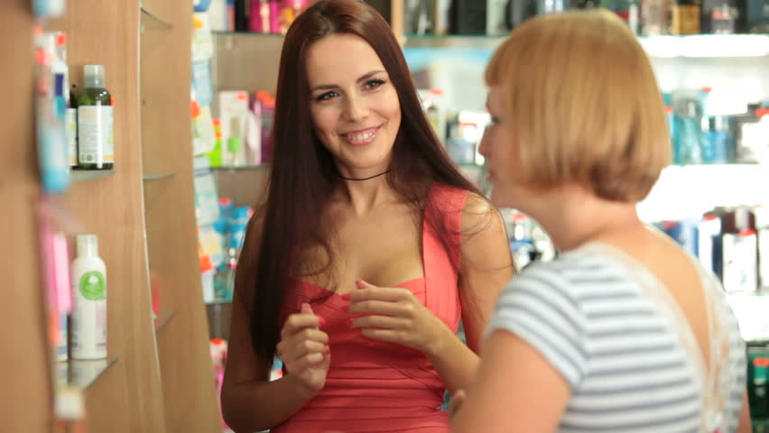 Beautiful Young Woman Buying Cosmetics