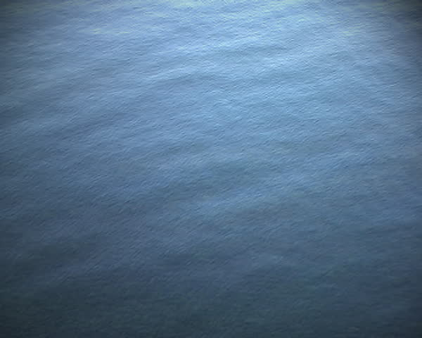 Calm Water Texture stone falls into calm water at sunset or sunrise and produces