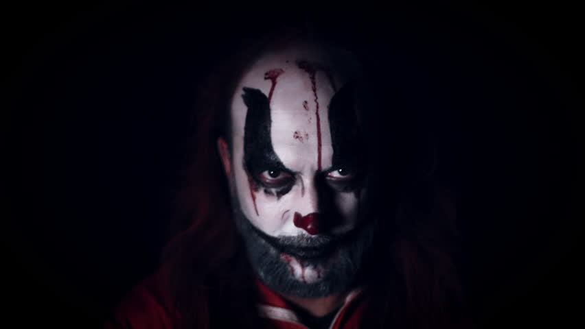 4k Halloween Horror Clown Man with Red Balloon | Shutterstock HD Video #26545955