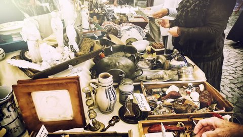 Sunday flea market with outdoor stands with antiques and other collector's items. Full HD, 1080p