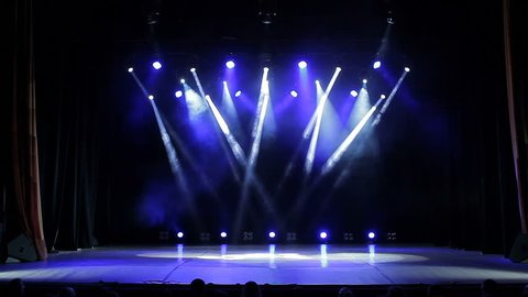 Colorful Bright Stage Lights in a Concert. Empty Stage at Concert With White and Blue Spotlights.