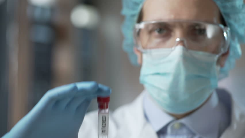 Special laboratory employee showing experimental Ebola virus vaccine, healthcare | Shutterstock HD Video #26641225
