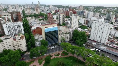 Aerial drone scene of city landscape. The camera travels through the city streets, towers, trees and buildings. Buenos Aires-Argentina