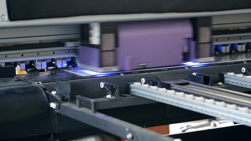 Working industrial large format UV printer for printing on big plastic panel. Printer machine inkjet during production.    Shutterstock HD Video #26690155