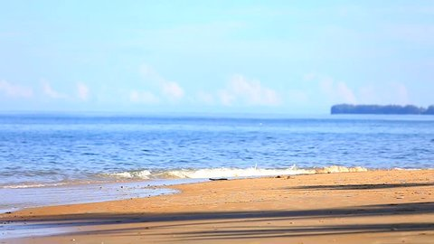 Long hair Asian woman running on tropical beach in sunlight of morning with blue sky in background, exercise in nature and fresh air for good health