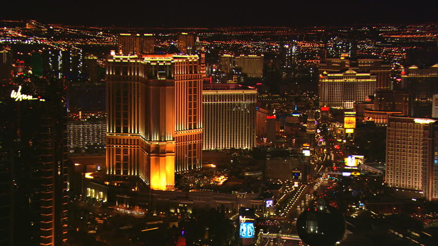 Close night flight past the Palazzo in Las Vegas. Shot in 2008. | Shutterstock HD Video #26704765