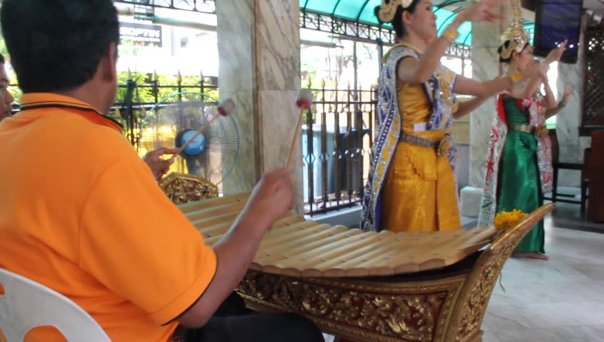 "BANGKOK - CIRCA JULY 2012 : Many people visit ""Pra Prum"" to get a good luck at Era-wan junction circa July 2012 in Bangkok, Thailand."