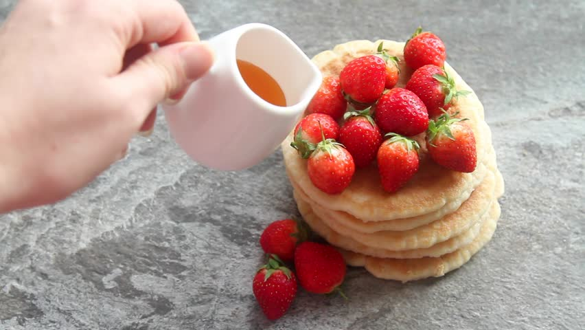 Homemade pancakes with strawberries and sauce food for breakfast homemade pancakes with strawberries and sauce food for breakfast hd stock video clip ccuart Choice Image