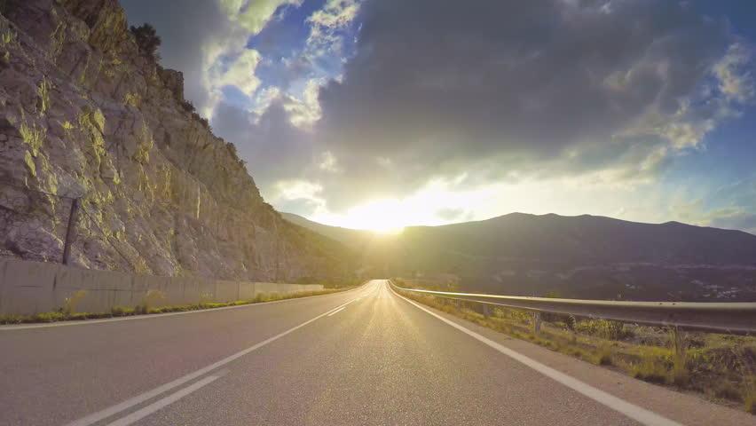 POV vehicle drive across beautiful remote mediterranean nature, sun light flashing cloudy sky, coastal curvy road, point of view car travel   Shutterstock HD Video #26777905