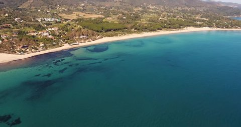 Aerial shot of a beautiful beach on Elba island with its  gorgeous paradisiac sea in Tuscany, Italy, 4K
