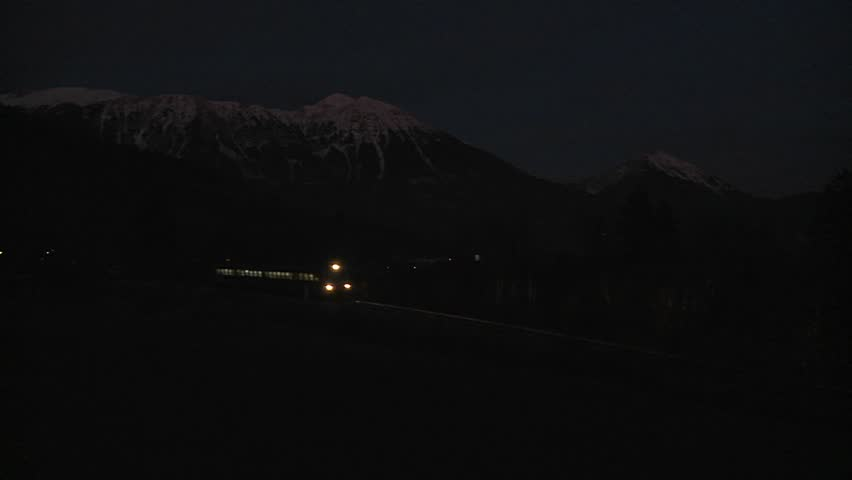 SWISS ALPS, SWITZERLAND-CIRCA 2011-A train passes in the dead of night.