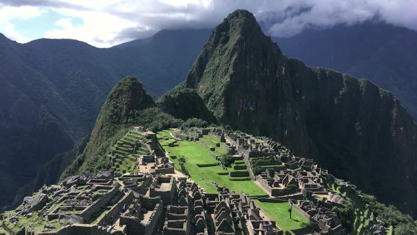 Machu Picchu, the lost city of the Andes with Llama on green grass field, Machu Picchu located above the Sacred Valley of Cuzco, Machupicchu District, Urubamba Province, Cusco Region, Peru.