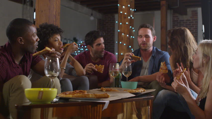 Young adults sharing pizzas at a party at home, shot on R3D   Shutterstock HD Video #26816065