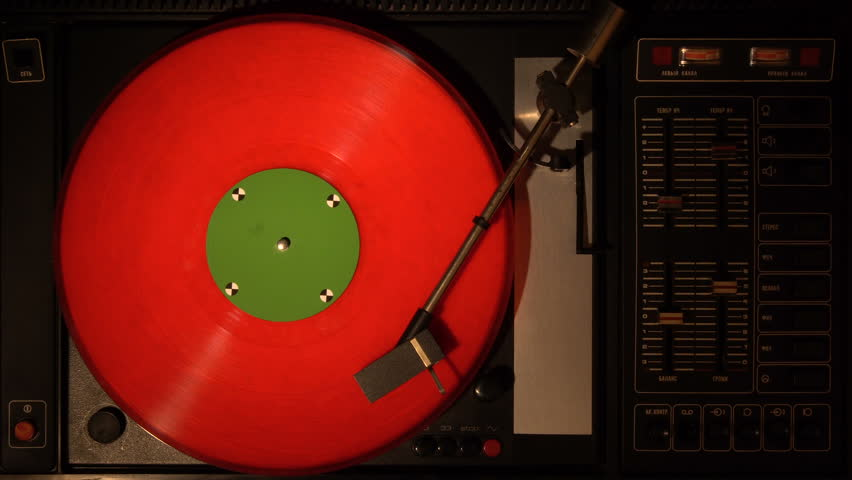 Vinyl record player. Plays song from an old turntable 4k top view. Black background. Music round plate rotate. Music disc turn. Tracking shot rotating disk with chroma-key green screen. Tracking point.