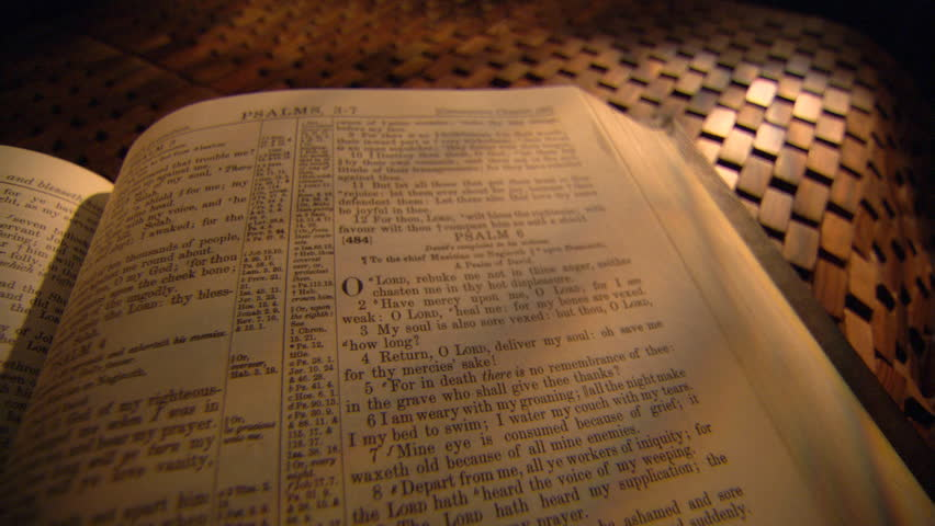 Left pan across close-up Bible opened to Psalms