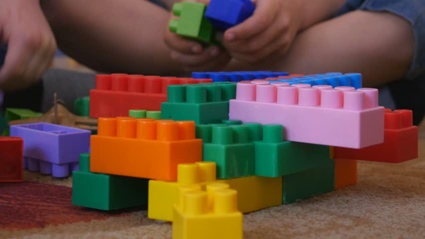Children play in the designer in kindergarten