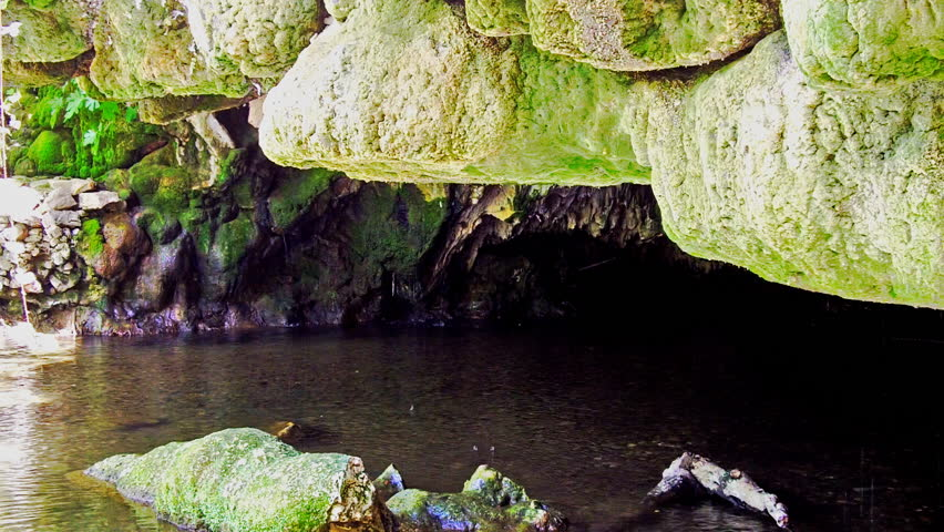 The opening or mouth of an underground river cave at Natural Bridges Hiking