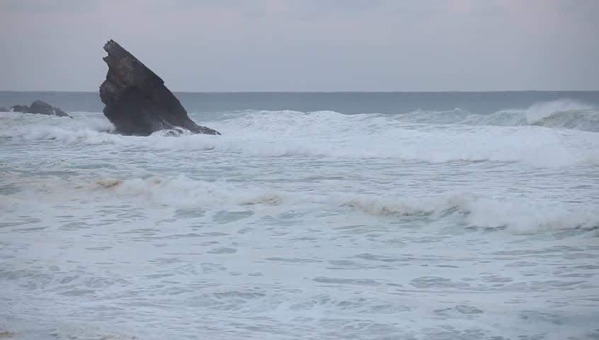 Big stormy waves beside the rocky cliff. Atlantic ocean coastline #26888755