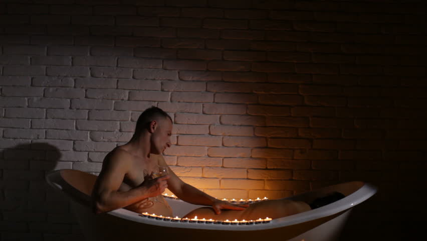 Young couple relaxing in a spa. Health and beauty, resort and relaxation concept - couple in spa salon getting massage. Love story. Sensual couple. Couple in love. Erotic game. Love concept. Bath room