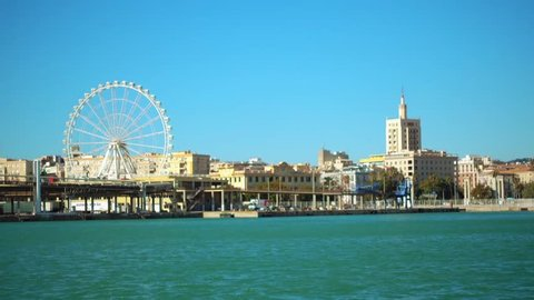 Port in Malaga. Malaga is municipality in Autonomous Community of Andalusia, Spain. Southernmost large city in Europe, it lies on Costa del Sol of the Mediterranean.