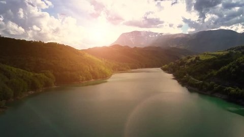 Aerial view of a fresh water lake and Dam in Central Italy. This video was captured using a drone