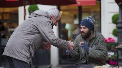 helping a homeless: pity, generosity, brotherhood