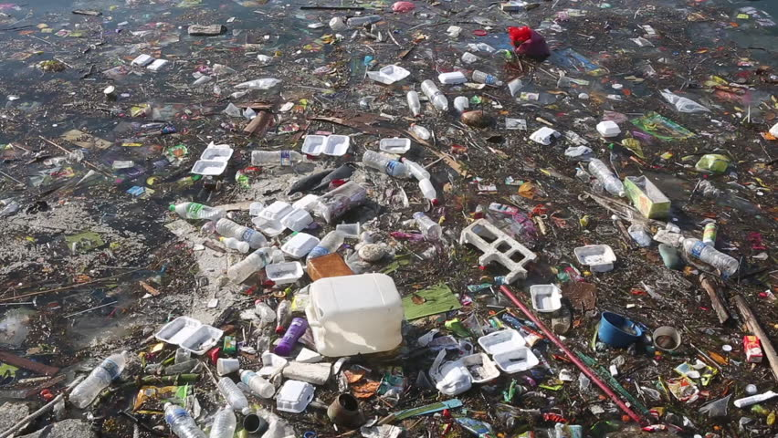 Plastic bottles and other trash floating in polluted ocean #26940775