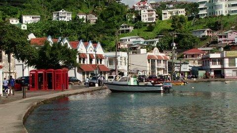 ST GEORGE'S/GRENADA - 6TH DECEMBER 2010: People walking on street beside St George's Inner Harbour, Grenada