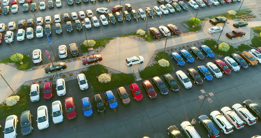 New car dealership lot, many vehicles for sale, aerial view.  | Shutterstock HD Video #26964055
