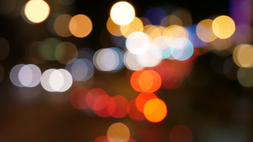 An out of focus shot of people and lights in a busy city at night | Shutterstock HD Video #26965375
