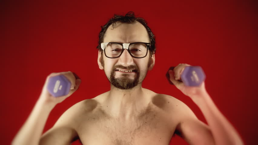 A funny ugly slim nerd man, exercising his arms with some weights, disappearing because of the excessive effort.