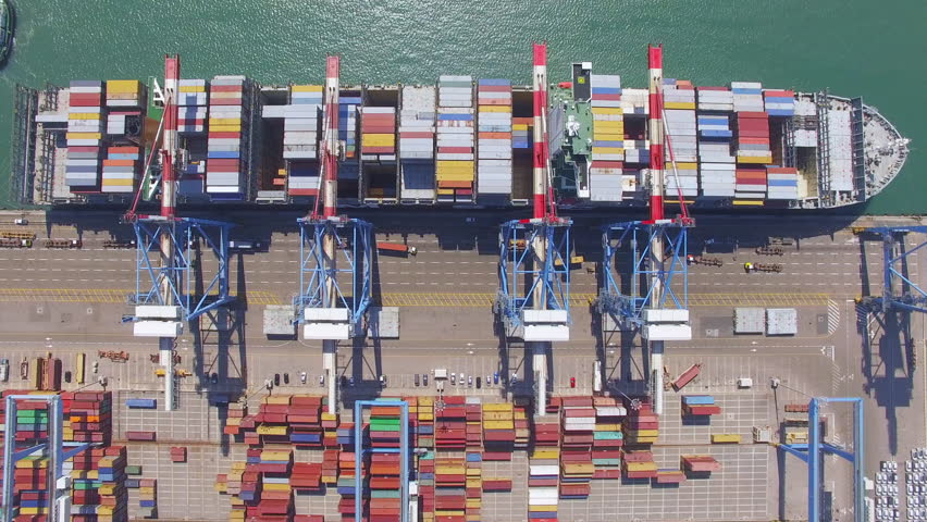 Commercial port with container ship during loading and unloading - Top down view. | Shutterstock HD Video #26983255