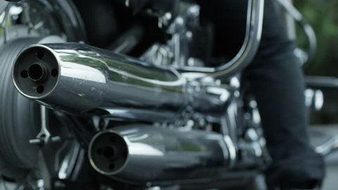 Close up of biker getting off his custom motorcycle. Shot on RED EPIC Cinema Camera in slow motion.