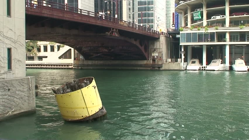 Boat traffic under bridge on Chicago River in downtown Chicago.